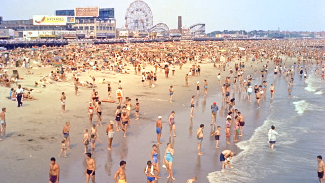 day med. angle of coney island beach; beach goers (period 1958) - coney island brooklyn stock videos & royalty-free footage