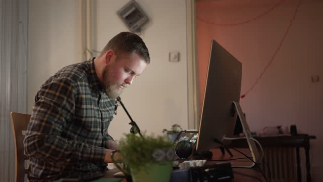 day of a music producer while working from his modern home studio office - film montage stock videos & royalty-free footage
