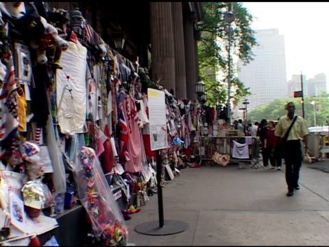 day of closing ceremony at ground zero may 30 2002 pedestrians walk past memorial displayed on railings of trinity church near ground zero audio... - mourning stock videos & royalty-free footage