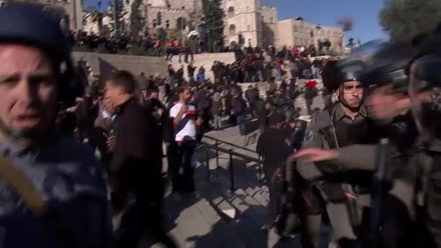'Day of Rage' protests Violent clashes between Palestinians and Israeli troops ISRAEL Jerusalem EXT Crowd of Palestinian protesters rushing forwards...