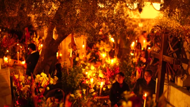 day of the dead celebration in the mixquic cementery on november 1 2017 in mexico city mexico the religious syncretism which combines catholic and... - paganism stock videos and b-roll footage