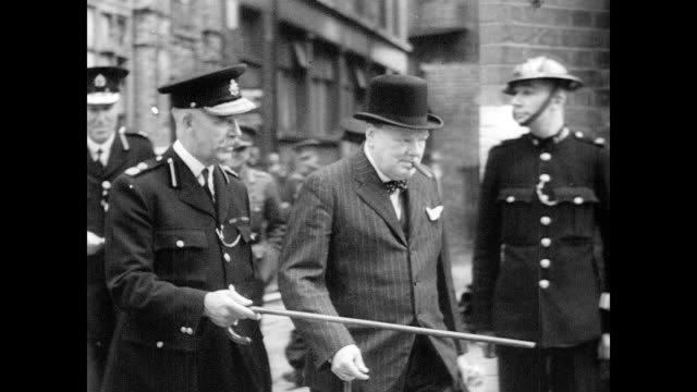 / day time look at air raid damage from German blitz attacks / Winston Churchill on the streets speaking with firefighters and assessing damage...