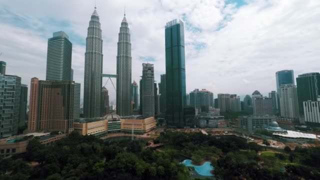 day timelapse in kuala lumpur - 4k - petronas twin towers stock videos & royalty-free footage