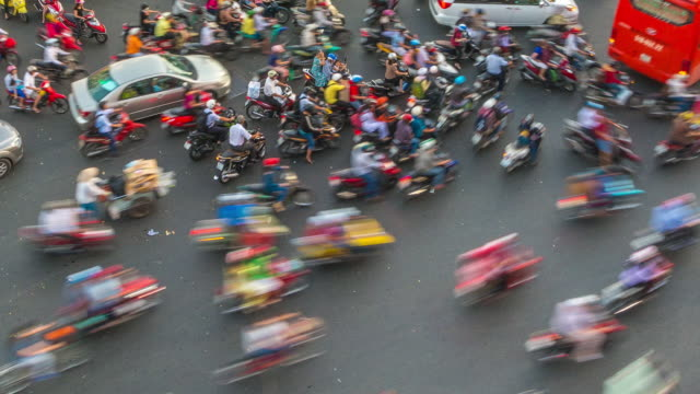 Day Timelapse of Busy Motorbike Traffic at Six Way Junction in Ho Chi Minh City (Saigon), Vietnam (Close Up)