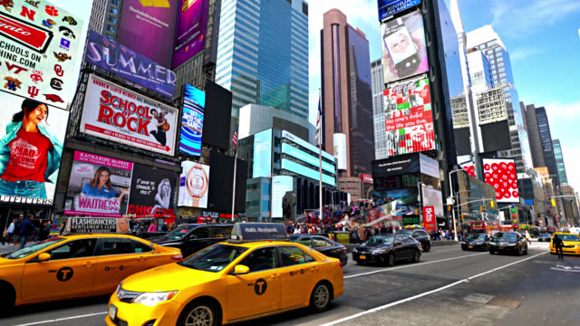 day. times square. yellow taxi - yellow taxi stock videos & royalty-free footage