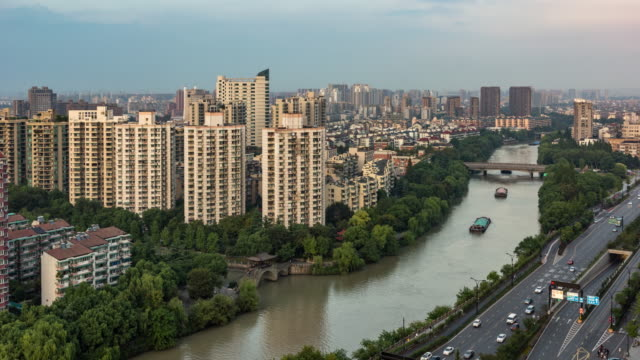 day to dusk 4k time-lapse:hangzhou cityscape along the grand canal at dusk,china - day to dusk stock videos & royalty-free footage