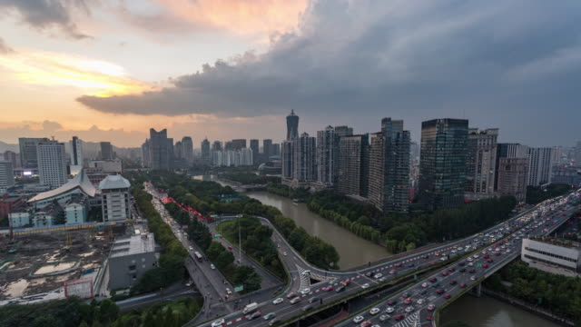 day to dusk 4k time-lapse:sunset over hangzhou skyline,china - day to dusk stock videos & royalty-free footage