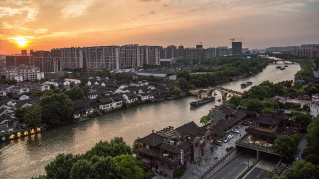 day to night 4k time-lapse:gongchen bridge on the grand canal at dusk,hangzhou,china - time of day stock videos and b-roll footage