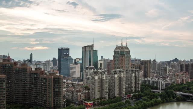 day to night 4k time-lapse:hangzhou skyline rainstorm at sunset,china - sunset to night time lapse stock videos & royalty-free footage