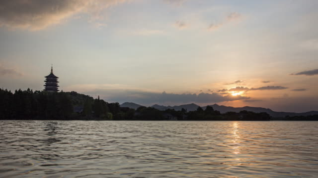day to night 4k time-lapse:hangzhou west lake,china - day to sunset stock videos & royalty-free footage