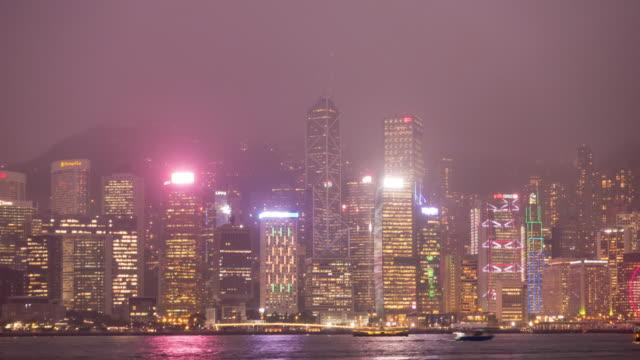 stockvideo's en b-roll-footage met 4 k tl dag naar nacht: gebouw en wolkenkrabber in hong kong stad. - hong kong