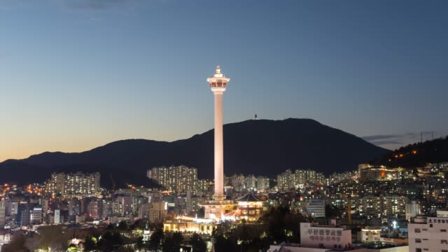 day to night busan tower and busan city skyline at south korea - busan stock videos & royalty-free footage