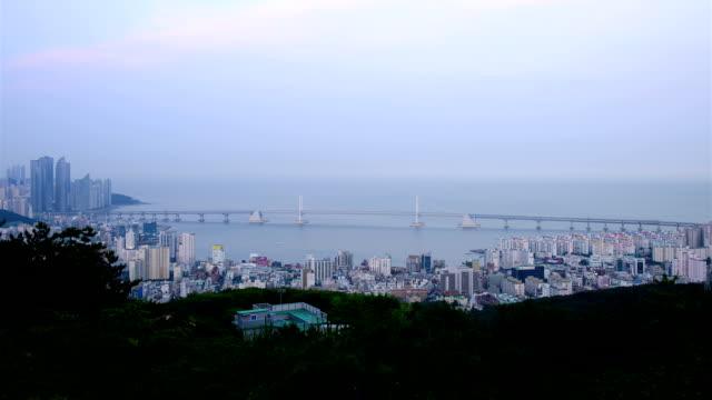 day to night cityscape of gwangandaegyo bridge / suyeong-gu, busan, south korea - busan stock videos & royalty-free footage