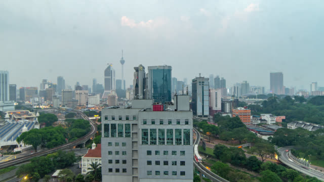day to night hazy sunset time lapse. kuala lumpur. zoom out - sunset to night stock videos & royalty-free footage