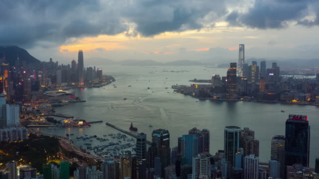 day to night hyperlapse of hong kong urban skyline with zoom out - victoria harbour hong kong stock videos & royalty-free footage
