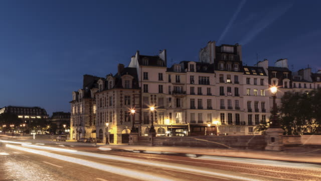day to night hyperlapse on pont neuf with light trails on street - monument stock videos & royalty-free footage