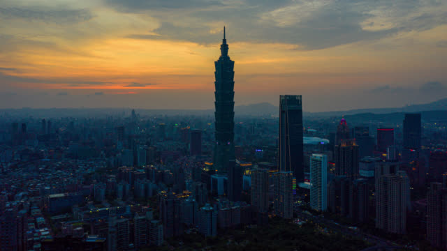 day to night hyperlapse or dronelapse aerial view of business district in city of taipei, taiwan - taipei video stock e b–roll