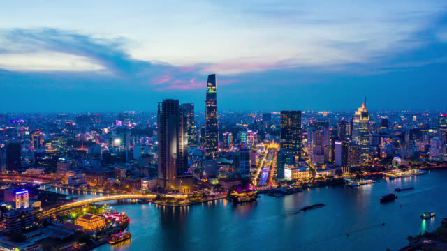 day to night hyperlapse or dronelapse of ho chi minh city skyline in vietnam - vietnam stock videos & royalty-free footage