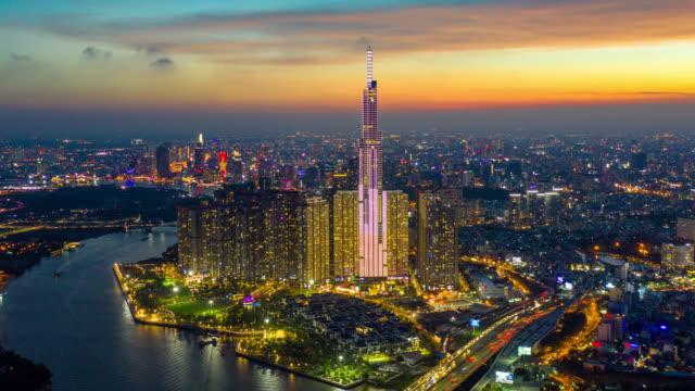 vídeos de stock e filmes b-roll de day to night hyperlapse or dronelapse of ho chi minh city skyline in vietnam - vietname