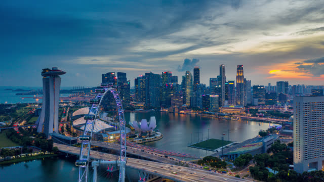 day to night hyperlapse or dronelapse scene of singapore business district downtown at sunset - singapore stock videos & royalty-free footage