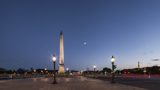 day to night hyperlapse / time lapse on place de la concorde in paris with car light trails - obelisk stock videos & royalty-free footage