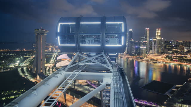 tl/hl day to night hyperlapse/time lapse of singapore skyline from the singapore flyer, showing financial district - singapore flyer stock videos and b-roll footage