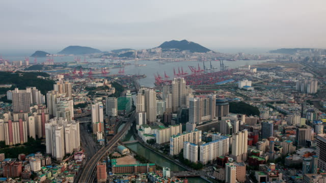 day to night landscape of busan harbor and a large bridge from munhyeondong - cloud computing stock videos & royalty-free footage