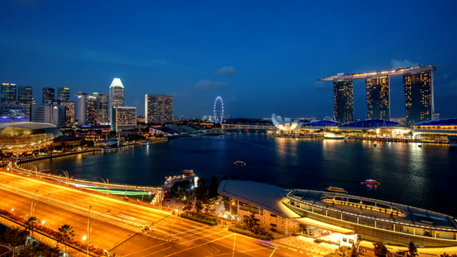 day to night marina bay singapore - marina bay sands stock videos and b-roll footage