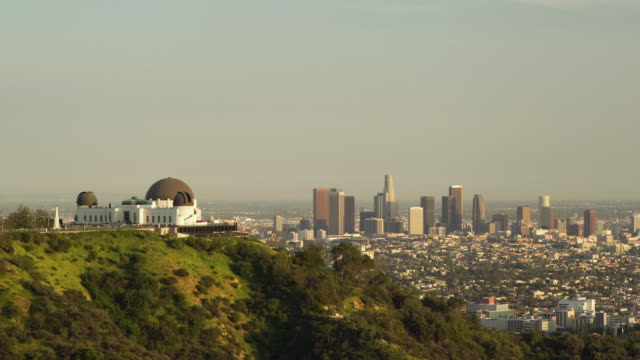 WS T/L Day to night of Griffith Park Observatory with downtown Los Angeles behind / Los Angeles, California, USA