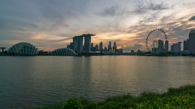 day to night scene timelapse of singapore business district downtown at sunset - chance stock videos & royalty-free footage