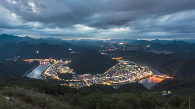 day to night scenery of downtown from yangbangsan observatory / danyang-gun, chungcheongbuk-do, south korea - dorf stock-videos und b-roll-filmmaterial