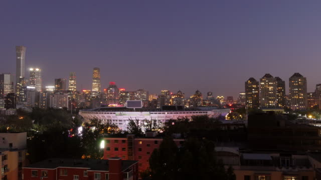 tl – day to night shot of beijing skyline with workers stadium – wide shot - spoonfilm stock videos and b-roll footage