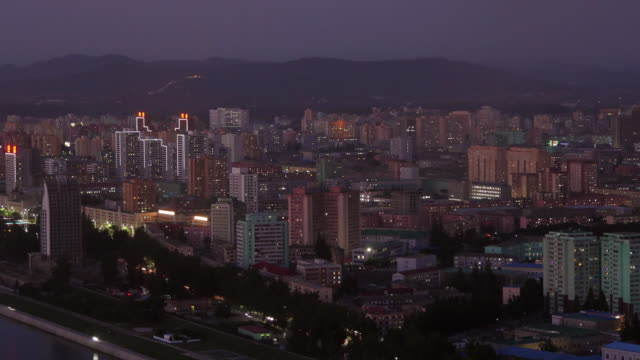 tl- day to night shot of the colorful houses in taedonggang district, in pyongyang, north korea, drpk. wide shot from above - north korea stock videos & royalty-free footage