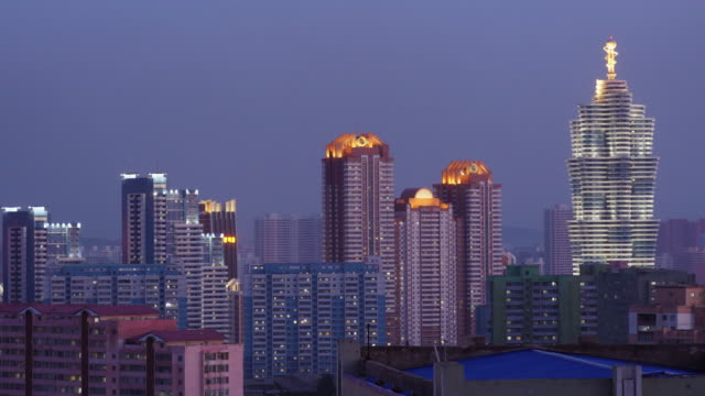 day to night skyline of futuristic buildings at mirae scientists street in pyongyang, north korea, dprk. seen from koryo hotel. - spoonfilm stock videos and b-roll footage
