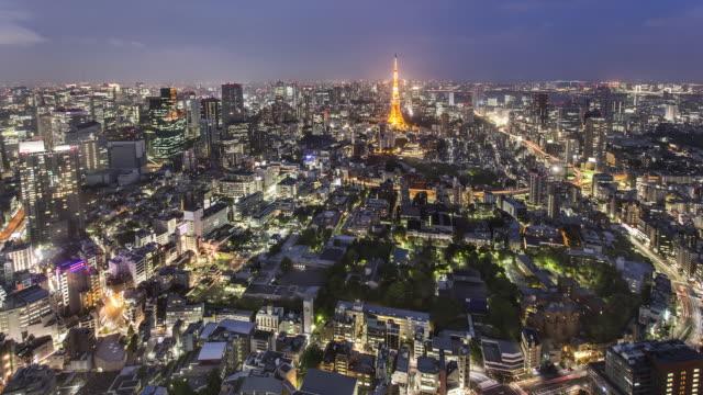 TL, WS Day to night skyline of Tokyo skyline with Tokyo Tower, Hamamatsucho, Shiodome, and Shinbashi skyscrapers /Tokyo, Japan