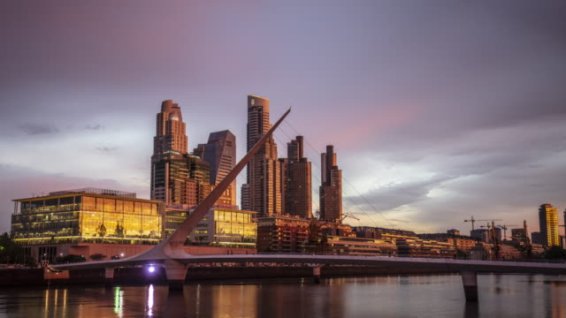 day to night time lapse at puerto madero - puente de la mujer stock videos & royalty-free footage