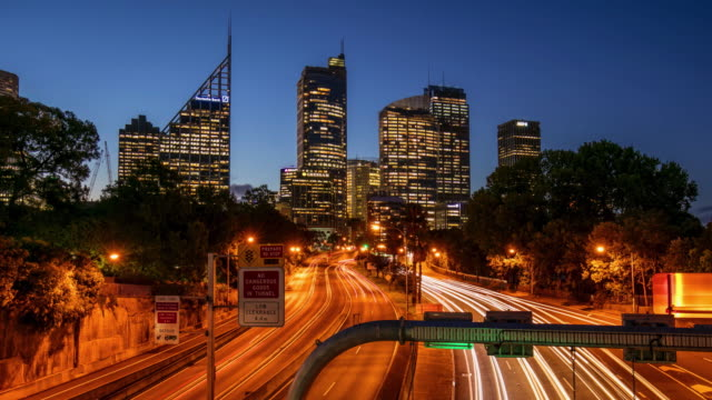 day to night time lapse in a centric road at sydney, australia - motorway stock videos & royalty-free footage