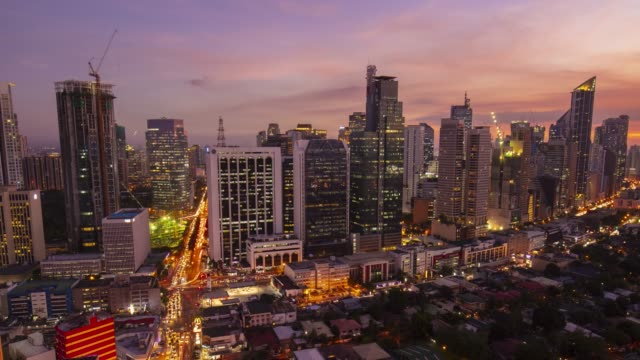 day to night time lapse in makati, manila, philippines - manila philippines stock videos and b-roll footage