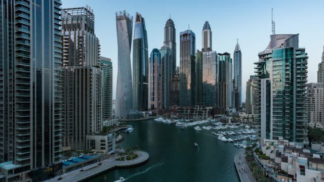 day to night /time lapse modern skycrapers in dubai marina - dubai stock videos & royalty-free footage