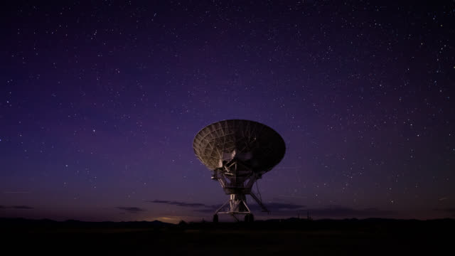 day to night time lapse of a telescope at the very large array - astronomy telescope stock videos & royalty-free footage