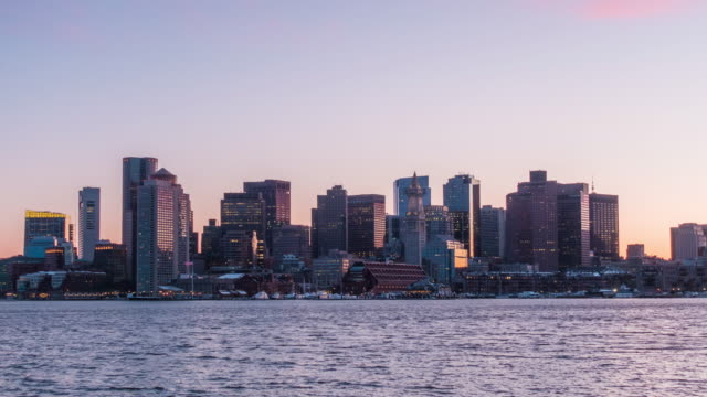 Day to night time lapse of Boston harbor skyline