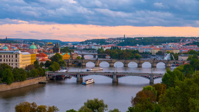 day to night time lapse of charles bridge and the vltava river flowing through prague, czech republic - river vltava stock videos & royalty-free footage