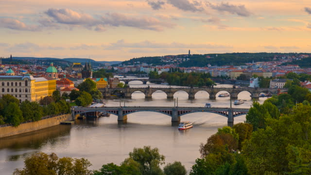 day to night time lapse of charles bridge and the vltava river flowing through prague, czech republic - charles bridge stock videos & royalty-free footage