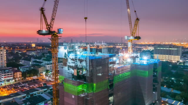 day to night time lapse of construction site - scaffolding stock videos & royalty-free footage