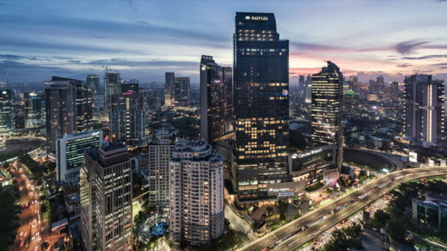 day to night time lapse of downtown jakarta skyline - indonesia video stock e b–roll