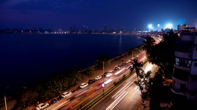 day to night time lapse of marine drive, mumbai - famous place stock videos & royalty-free footage