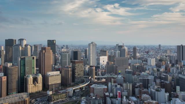 Day to night time lapse of Osaka skyline Japan