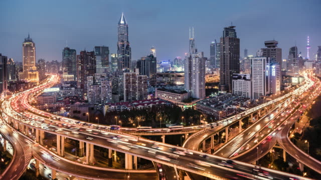 day to night time lapse of road intersection shanghai