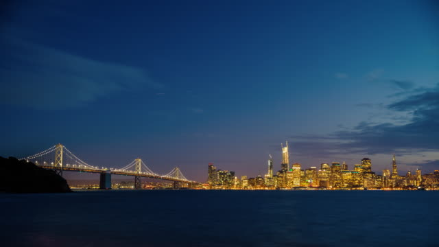 day to night time lapse of san francisco skyline - san francisco oakland bay bridge stock videos and b-roll footage