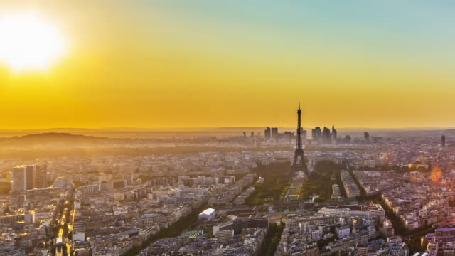 Day to night time lapse of sunset over Paris skyline.